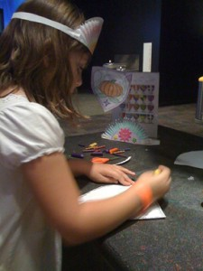 Kids can make their own crowns and shields at the Lego Exhibit