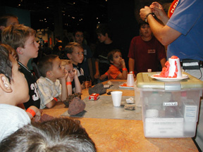 A Science Center employee shares a demonstration on volcanoes